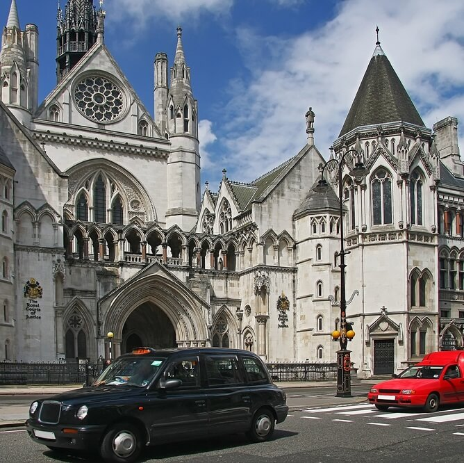 London taxi in front of royal courts of justice
