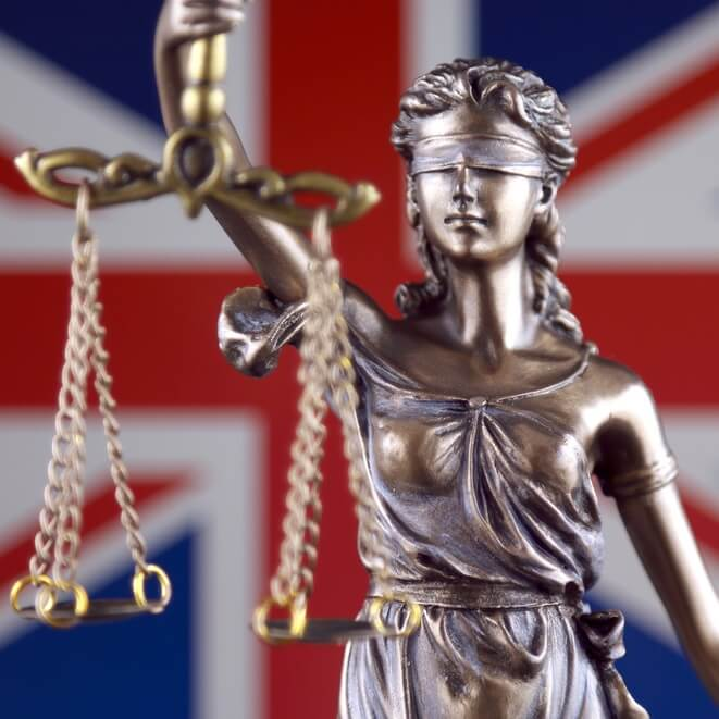 Symbol of law and justice with United Kingdom Flag